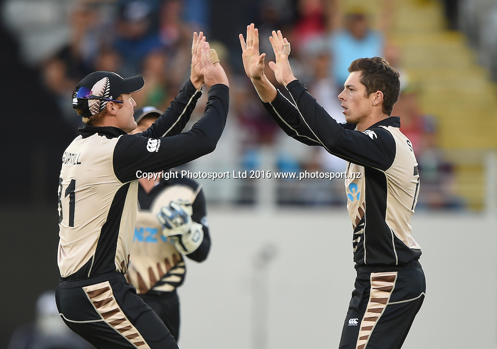 Martin Guptill and Mitchell Santner celebrates the wicket of Maqsood at the Twenty20 match between New Zealand Black Caps and Pakistan at Eden Park in Auckland, New Zealand. Friday 15 January 2016. Copyright photo: Andrew Cornaga / www.photosport.nz