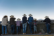 A family of Mexican cowboys look out from the top of Cubilete Mountain at the end of the annual Cabalgata de Cristo Rey pilgrimage January 6, 2017 in Guanajuato, Mexico. Thousands of Mexican cowboys take part in the three-day ride to the mountaintop shrine of Cristo Rey.