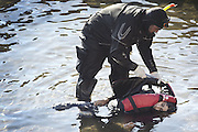 Oct. 15, 2015 - Lesbos Island, Greece - <br /> <br /> European Migrant Crisis<br /> <br /> A rescue diver picks a dead child from the water after a Greek Coast Guard vessel hit a migrant boat killing at least nine.<br /> ©Exclusivepix Media