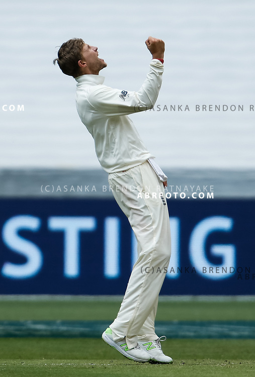 Joe Root celebrates the wicket of David Warner during day 5 of the 2017 boxing day test.