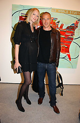 Model  JADE PARFITT and TOBY BURGESS at a reception to celebrate the opening of 'USA Today' - an exhibition of work from The Saatchi Gallery held at The Royal Academy of Arts, Burlington Gardens, London on 5th September 2006.<br />