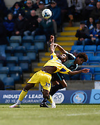 Accrington midfielder Tariqe Fosu is brought man-handled by Wycombe defender Sido Jombati, resulting in a free kick and a booking,  during the Sky Bet League 2 match between Wycombe Wanderers and Accrington Stanley at Adams Park, High Wycombe, England on 30 April 2016. Photo by David Charbit.