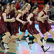 De Pere's celebrates an overtime win over Middleton during the Division 1 semifinals of the WIAA girls' state basketball championships Friday, March 10, 2017 in Green Bay, Wis. De Pere won 49-47   (AP Photo/Matt Ludtke)