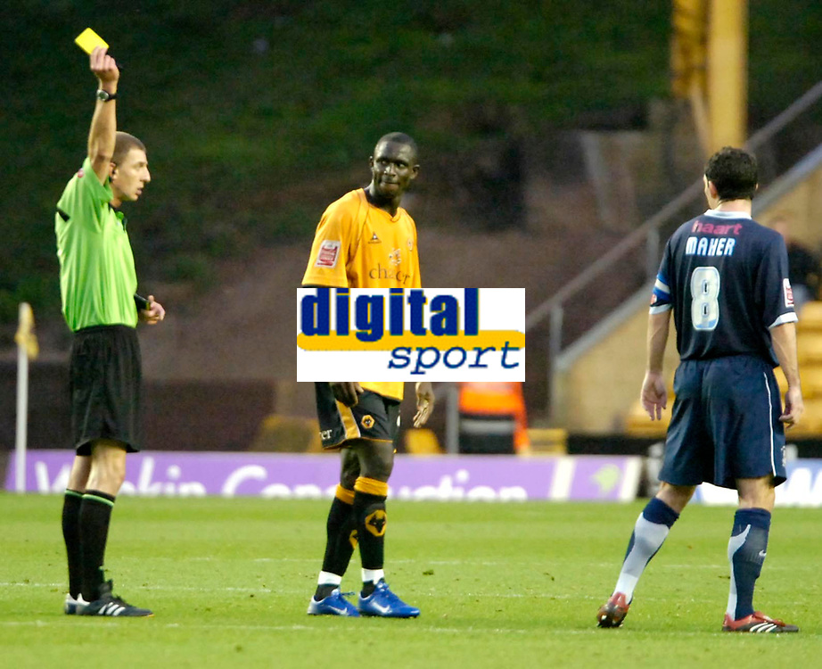 Photo: Ed Godden.<br /> Wolverhampton Wanderers v Southend United. Coca Cola Championship. 04/11/2006. Referee Steve Tanner shows the yellow card to Wolves' Seyi Olofinjana (centre) and Southend's Captain Kevin Maher (R).