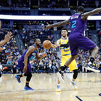 04 March 2017: Denver Nuggets guard Jamal Murray (27) passes the ball past Charlotte Hornets guard Kemba Walker (15) and Charlotte Hornets forward Marvin Williams (2) to Denver Nuggets forward Darrell Arthur (00) during the Charlotte Hornets 112-102 victory over the Denver Nuggets, at the Pepsi Center, Denver, Colorado, USA.