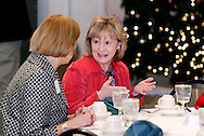 Cheryl Canne (left) talks with Charlotte Miller of the Cox Media Group during the South Metro Regional Chamber of Commerce Holiday Extravaganza at Sycamore Creek Country Club in Springboro, Wednesday, December 14, 2011.