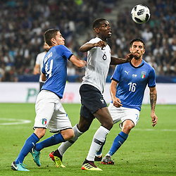 Paul Pogba of France and Lorenzo Pellegrini of Italy during the International Friendly match between France and Italy at Allianz Riviera Stadium on June 1, 2018 in Nice, France. (Photo by Anthony Dibon/Icon Sport)