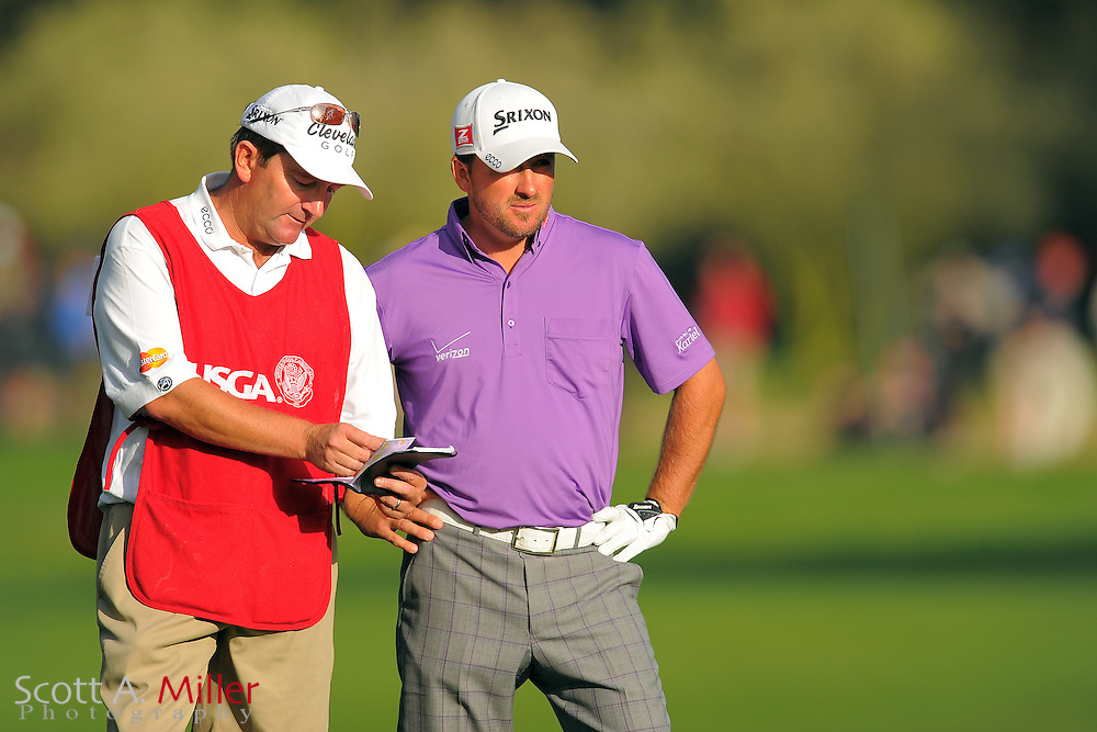 Graeme McDowell and his caddie Ken Comboy during the third round of the 112th U.S. Open at The Olympic Club on June 16, 2012 in San Fransisco. ..©2012 Scott A. Miller
