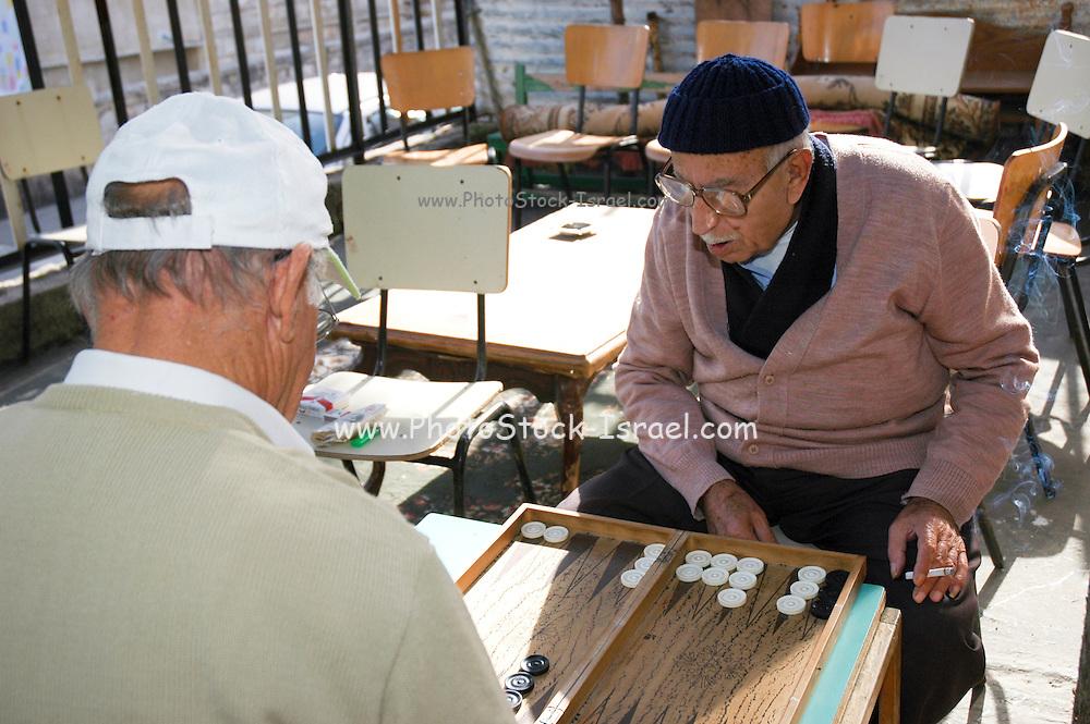 Israel, Haifa, Wadi Nisnas, two mature men playing backgammon