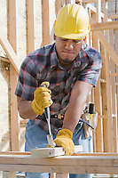 Construction worker at work on building