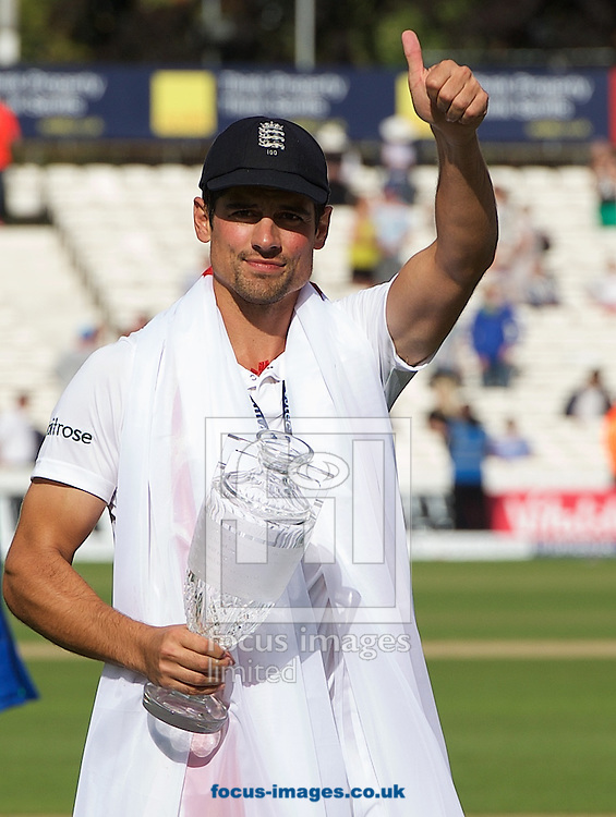 Captain Alastair Cook of England gives a thumbs up with the trophy after winning the Ashes test series during the 5th Investec Ashes Test match at the Kia Oval, London<br /> Picture by Alan Stanford/Focus Images Ltd +44 7915 056117<br /> 23/08/2015