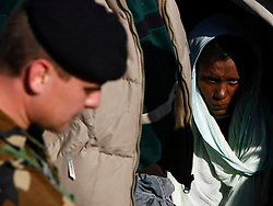 An African immigrant, fleeing the unrest in Libya, waits to disembark from a boat in Cirkewwa in the north of Malta March 29, 2011. A total of 281 immigrants from Eritrea, Ethiopia and Sudan arrived in Malta on Tuesday.  Malta has appealed to the international community for assistance in dealing with the current influx of illegal immigrants.  In an appeal during a London meeting for international powers to discuss Libya, Maltese Foreign Minister Tonio Borg said that the international community in general and the European Union in particular could not ignore the illegal immigration problem caused by the conflict, according to local media. REUTERS/Darrin Zammit Lupi (MALTA - Tags: CIVIL UNREST POLITICS SOCIETY IMAGES OF THE DAY) MALTA OUT. NO COMMERCIAL OR EDITORIAL SALES IN MALTA - RTR2KKBP