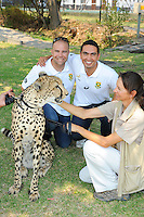 STELLENBOSCH, SOUTH AFRICA - Wednesday 20 January 2016, Ashley Evert and Sebastian Prim with Phoenix the cheetah during the launch of Springbok 7's new jersey with Steinhoff International as sponsor at the Markotter Indoor facility in Stellenbosch.<br /> Photo by Roger Sedres/ImageSA