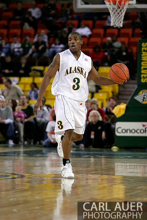 24 November 2005:  University of Alaska Anchorage senior guard Kemmy Burgess sets the offense in the UAA Seawolves 60-65 loss to the South Carolina Gamecock's in the first round of the Great Alaska Shootout at the Sullivan Arena in Anchorage Alaska.