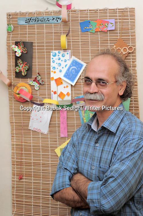 Farhad Hassanzadeh, born in 1962 in Abadan is co-founder of the Children and Young Adults Authors Institute, the largest NGO of Iranian authors. He serves as judge in various literary, film and theatre festivals for children. Hassanzadeh holds the most popular creative writing workshops in the country and has been awarded thirty national awards for his works. He has also been awarded the artistic emblem of literature for 25 years of successful literary work.<br /> 21st August 2013<br /> <br /> Photograph by Babak Sedighi/Writer Pictures<br /> <br /> WORLD RIGHTS