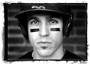 """SHOT 5/22/11 12:45:21 PM - The Denver Browns third baseman Matthew Jerebker poses for a portrait in the dugout. The Browns beat the Denver Bulls 14-0 as they play baseball at Denver East High School. The Denver Browns play semi-professional baseball are were founded in 2007 by Gino Grasso and managed by Matthew Repplinger with the goal of developing amateur baseball players starting at the Little League level and continuing through to Big Leaguers. The Browns won the """"2010 NABA 18AAA Championship"""" and finished with a 2010 record of 20-3. (Photo by Marc Piscotty / © 2011)"""