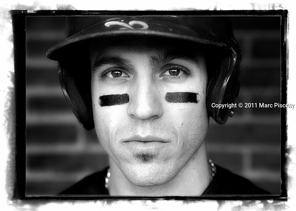 "SHOT 5/22/11 12:45:21 PM - The Denver Browns third baseman Matthew Jerebker poses for a portrait in the dugout. The Browns beat the Denver Bulls 14-0 as they play baseball at Denver East High School. The Denver Browns play semi-professional baseball are were founded in 2007 by Gino Grasso and managed by Matthew Repplinger with the goal of developing amateur baseball players starting at the Little League level and continuing through to Big Leaguers. The Browns won the ""2010 NABA 18AAA Championship"" and finished with a 2010 record of 20-3. (Photo by Marc Piscotty / © 2011)"
