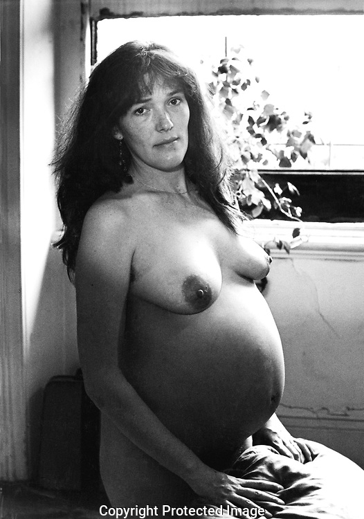 Portrait of pregnant woman about to give birth.