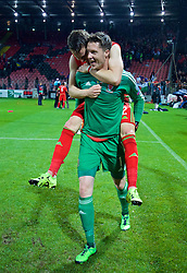 ZENICA, BOSNIA & HERZEGOVINA - Saturday, October 10, 2015: Wales' goalkeeper Wayne Hennessey and Chris Gunter celebrate qualifying for the Euro 2016 finals despite a 2-0 defeat to Bosnia and Herzegovina during the UEFA Euro 2016 qualifying match at Stadion Bilino Polje. (Pic by David Rawcliffe/Propaganda)