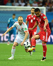 KAZAN, June 20, 2018  Andres Iniesta (L) of Spain vies with Omid Ebrahimi of Iran during a Group B match between Spain and Iran at the 2018 FIFA World Cup in Kazan, Russia, June 20, 2018. (Credit Image: © Liu Dawei/Xinhua via ZUMA Wire)