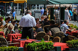 A busy café in Grote markt, Bruges, Belgium.<br /> <br /> (c) Andrew Wilson | Edinburgh Elite media