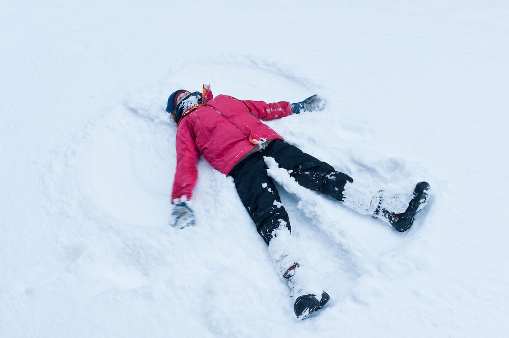 Girl creating a snow angel