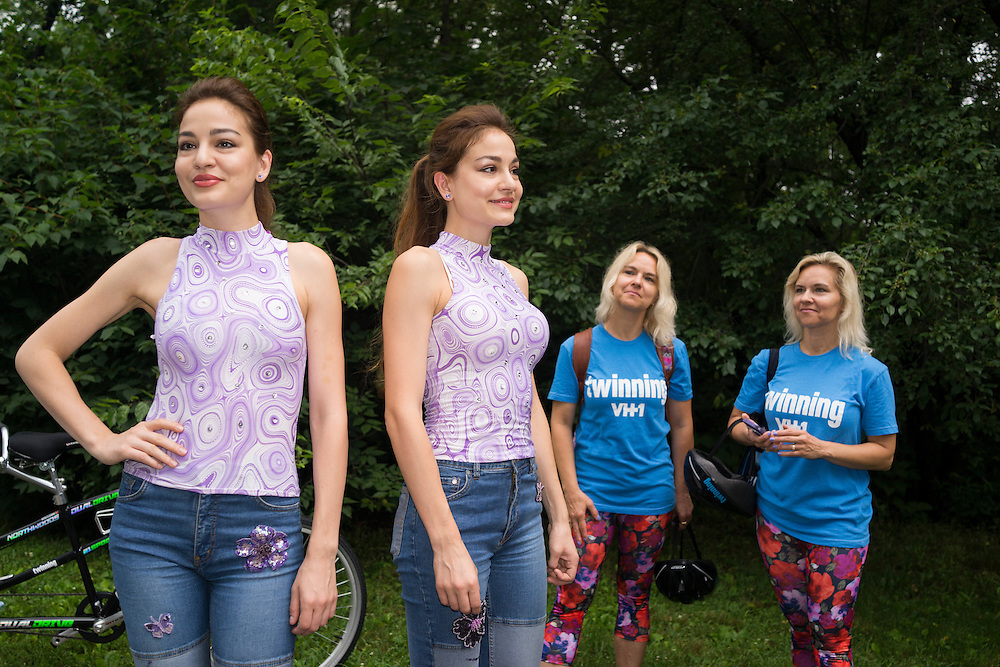 Two sets of twins gather before hundreds of twins ride tandem bikes in an attempt to set the record for the most twins ever riding tandem bikes, in Central Park in New York City on July 15, 2015.<br /> <br /> Photograph by Andrew Hinderaker