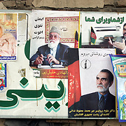 08 October 2004&#xD;&#xA;Kabul, Afghanistan.&#xD;&#xA;One day until elections in Afghanistan.&#xD;&#xA;&#xD;&#xA;With just one day until the people of Afghanistan go to the polls to have their say in choosing a new President Kabul is widely decorated with colourful posters explaining how to vote and encouraging the population to do so, these posters  are often located along with the propaganda material relating to various candidates.<br />