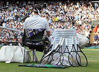 Tennis - 2019 Wimbledon Championships - Week Two, Sunday (Day Thirteen)<br /> <br /> Men's Singles, Final: Novak Djokovic (SRB) vs. Roger Federer (SUI)<br /> <br /> Federer sits down at the change over with his used tennis rackets, on Centre Court.<br /> <br /> COLORSPORT/ANDREW COWIE