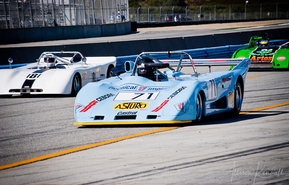 Historic cars racing at Laguna Seca during the Reunion events of Monterey Car Week