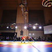 Obe Blanc, USA, (blue) in action against Hassan Rahimi, Iran, as wrestlers from USA, Iran and Russia compete at Grand Central Terminal as part of the Beat the Streets Gala. Billed ?The Rumble On The Rails,? the international wrestling event showcased competition as part of World Wrestling Month. Vanderbilt Hall, Grand Central Station, Manhattan,New York. USA. 15th May 2013. Photo Tim Clayton