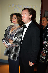 DORIT MOUSSAIEFF and GEORDIE GRIEG at Andy & Patti Wong's Chinese New Year party to celebrate the year of the Rooster held at the Great Eastern Hotel, Liverpool Street, London on 29th January 2005.  Guests were invited to dress in 1920's Shanghai fashion.<br />