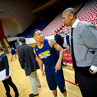 BLOOMINGTON, IN -- February 3, 2013 -- University of Michigan point guard Trey Burke is greeted by ESPN analyst Jalen Rose, a member of UM's The Fab Five in the early 90's, during their practice session before taking on the Indiana University Hoosiers.  The current Wolverines starters have been compared to them recently after their recent successes.  (PHOTO / CHIP LITHERLAND)