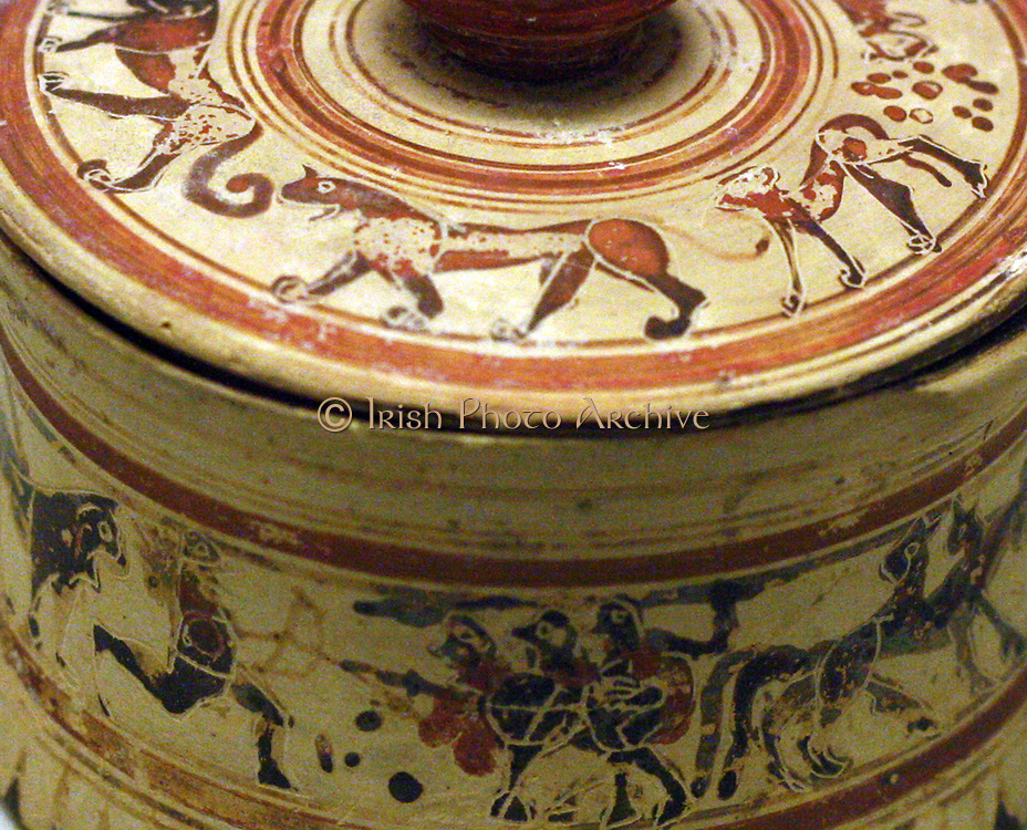 Detail from Greek cosmetic box, or 'pyxis' depicting Heracles fighting triple-bodied monster Geryon. Protocorinthian, made circa 680-650 BC in Corinth. From Phaleron, near Athens.