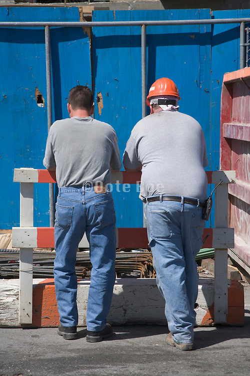 two construction workers taking a short break