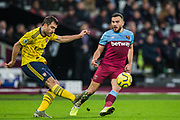 Sokratis (Arsenal) & Robert Snodgrass (West Ham) during the Premier League match between West Ham United and Arsenal at the London Stadium, London, England on 9 December 2019.