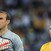 Mark Schwarzer and Lucas Neill (right) during the 2010 Fifa World Cup Asian Qualifying match between Australia and Uzbekistan at Stadium Australia in Sydney, Australia on April 01, 2009. Australia won the match 2-0.  Photo Tim Clayton