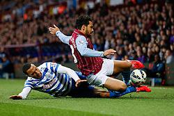 Kieran Richardson of Aston Villa is tackled by Matt Phillips of QPR - Photo mandatory by-line: Rogan Thomson/JMP - 07966 386802 - 07/04/2015 - SPORT - FOOTBALL - Birmingham, England - Villa Park - Aston Villa v Queens Park Rangers - Barclays Premier League.