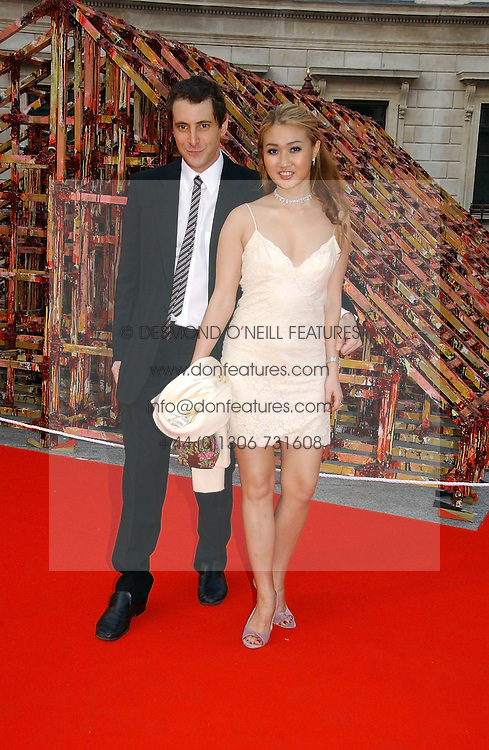 BRUCE WILPON and his wife YUKI OSHIMA-WILPON at the Royal Academy of Art's SUmmer Party following the official opening of the Summer Exhibition held at the Royal Academy of Art, Burlington House, Piccadilly, London W1 on 7th June 2006.<br />