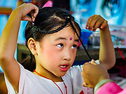26 AUGUST 2018 - GEORGE TOWN, PENANG, MALAYSIA: A child performer gets help with her hair before going on stage for a Hokkien style Chinese opera on the Lim Jetty in George Town for the Hungry Ghost Festival. The opera troupe came to George Town from Fujian province in China. The Hungry Ghost Festival is a traditional Buddhist and Taoist festival held in Chinese communities throughout Asia. The Ghost Festival, also called Ghost Day, is on the 15th night of the seventh month (25 August in 2018). During the Hungry Ghost Festival, the deceased are believed to visit the living. In many Chinese communities, there are Chinese operas and puppet shows and elaborate banquets are staged to appease the ghosts.     PHOTO BY JACK KURTZ