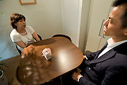 """Keiko"" (l) undertakes a class simulating a first date with her unidentified coach at Infini, a school training marriage hopefuls how to hook Mr. or Mrs. Right in Tokyo, Japan on Sep. 9, 2010."