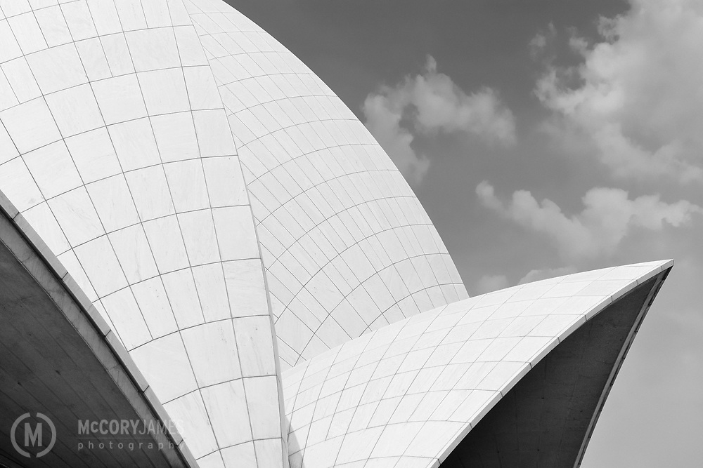 Black and white photograph of the Bahá'í House of Worship Lotus Temple in New Delhi, India. Designed by architect Fariborz Sahba.