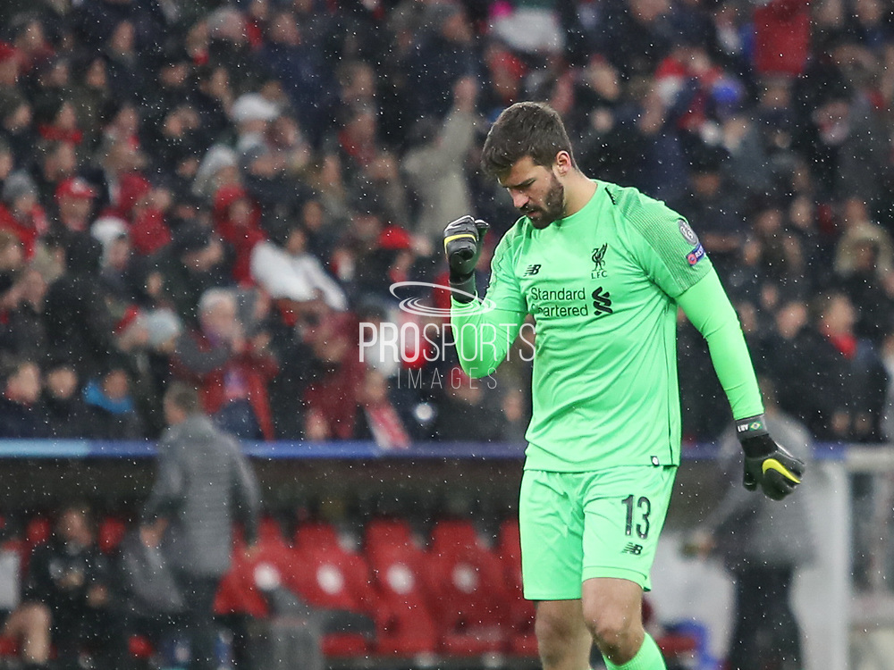 Alisson Becker of Liverpool celebrates during the Champions League round of 16, leg 2 of 2 match between Bayern Munich and Liverpool at the Allianz Arena stadium, Munich, Germany on 13 March 2019.