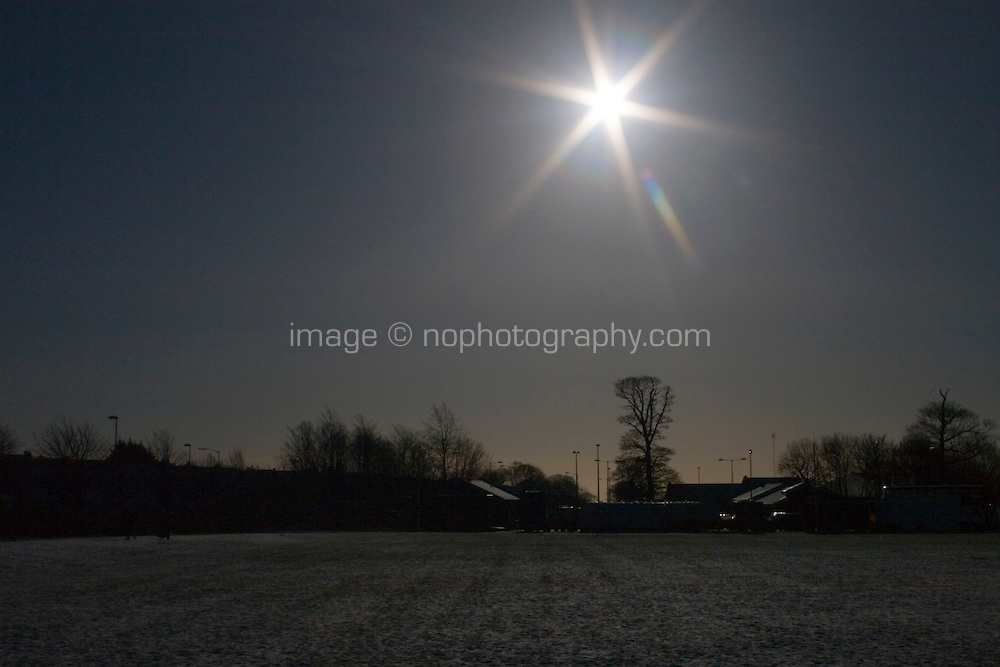 Early morning sunlight over snow covered field in suburban in Dublin Ireland