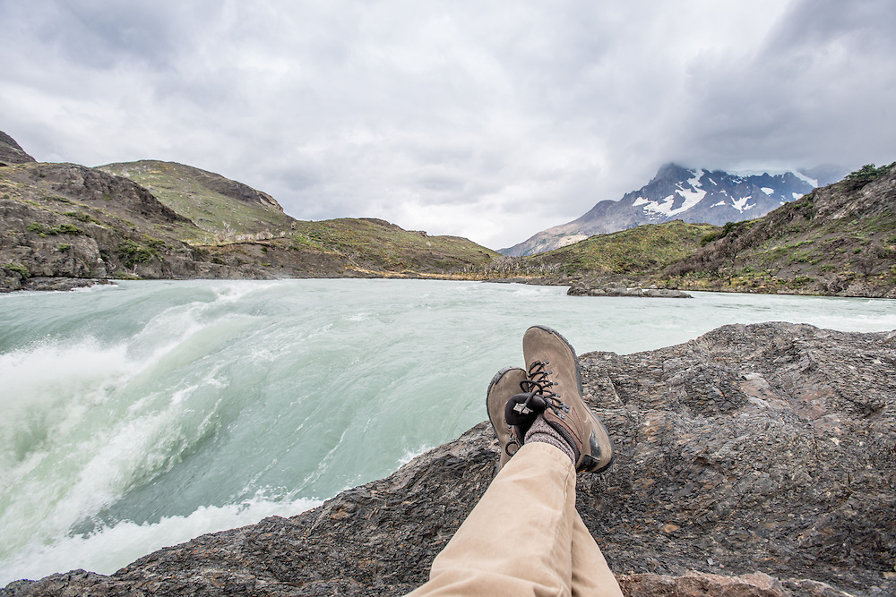 Hiker resting at Torres del Paine National Park, Patagonia Chile