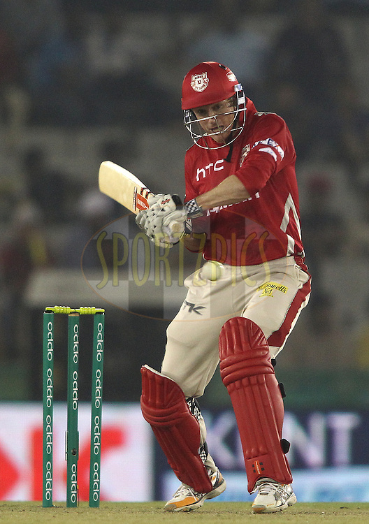 Kings XI Punjab captain George Bailey attempts to play a delivery square during match 2 of the Oppo Champions League Twenty20 between the Kings XI Punjab and the Hobart Hurricanes held at the Punjab Cricket Association Stadium, Mohali, India on the 18th September 2014<br /> <br /> Photo by:  Shaun Roy / Sportzpics/ CLT20<br /> <br /> <br /> Image use is subject to the terms and conditions as laid out by the BCCI/ CLT20.  The terms and conditions can be downloaded here:<br /> <br /> http://sportzpics.photoshelter.com/gallery/CLT20-Image-Terms-and-Conditions-2014/G0000IfNJn535VPU/C0000QhhKadWcjYs