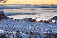 Clouds and morning light create this mesmerizing winter view over a portion of Bryce Canyon National Park at sunrise.
