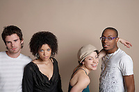 Studio portrait of four young people