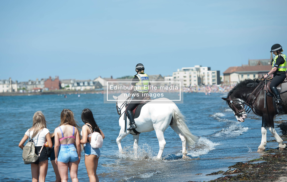Mounted Police take their horses into the water to help them cool down during today's extremely hot weather, Troon Beach, Troon, Friday 26 May 2017 Angie Isac   EEm