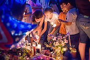 22 SEPTEMBER 2007 -- PHOENIX, AZ: People light candles and pray during a candlelight vigil for Phoenix Police Officer Nick Erfle was murdered Tuesday, Sept. 18, when he stopped a man for jaywalking on a Phoenix street. The man, Erik Martinez, was an illegal immigrant with a lengthy criminal history who had been deported from the United States and snuck back in. He was a member of a Mexican gang and wanted on felony assault warrants, which is why he shot Erfle when he was stopped for jaywalking. Martinez carjacked a passing vehicle in an effort to escape but was shot and killed a few miles from where he killed Erfle. Photo by Jack Kurtz / ZUMA Press